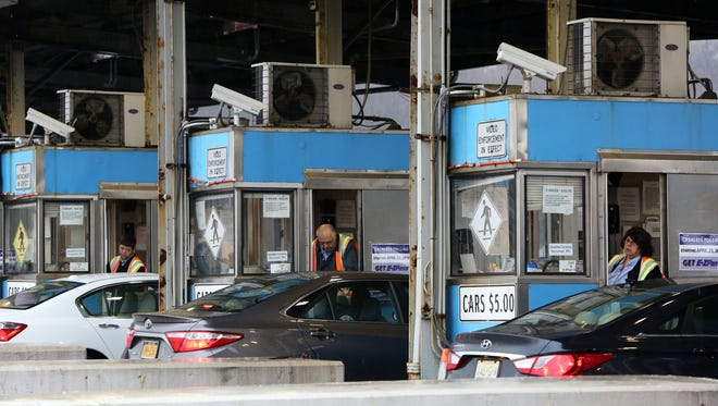 Toll booth workers collect money from drivers at the Tappan Zee Bridge toll booths in Tarrytown, April 12, 2016. Collectors will be reassigned because cashless tolling begins on the Tappan Zee Bridge on April 23rd.