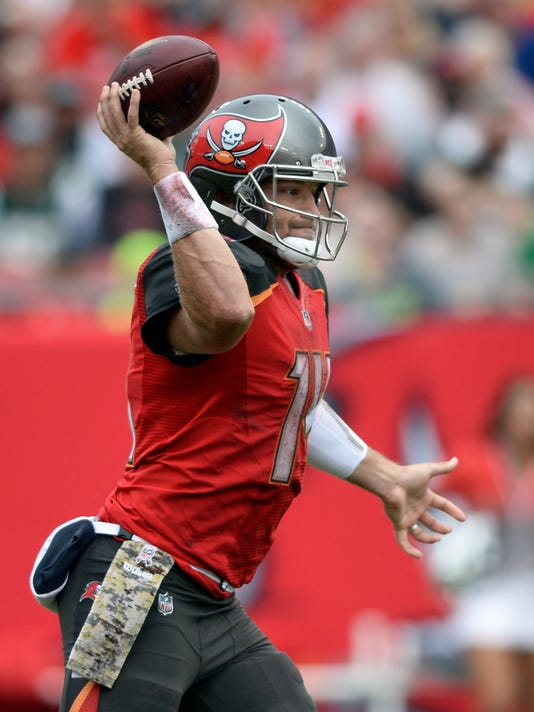 Tampa Bay Buccaneers quarterback Ryan Fitzpatrick (14) throws a pass against the New York Jets during the first half of an NFL football game Sunday, Nov. 12, 2017, in Tampa, Fla. Fitzpatrick is playing in place of injured Jameis Winston. (AP Photo/Jason Behnken)