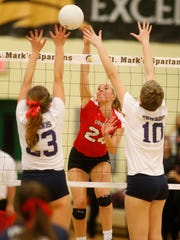 Ursuline's Kailyn Kampert tries to hit past Friends' Maya Johnson (left) and Alyssa Nathan in the fourth set of the Raiders' win during a quarterfinal of the DIAA state tournament Tuesday at St. Mark's High School.