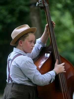 Conner Derryberry, 11, plays around on a stand up bass during the 39th Annual Uncle Dave Macon Days Festival, on Friday, July 08, 2016.