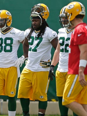 Green Bay Packers' John Crockett (38), Eddie Lacy (27), Aaron Ripkowski (22) and Aaron Rodgers (12) during organized team activities at Ray Nitschke Field on Thursday, June 2, 2016.