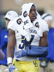 Delaware starting running back Wes Hills is left on