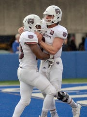 Missouri State tailback Calan Crowder is congratulated by quarterback Brodie Lambert after Crowder scored against the Indiana State defense during the Bears' 45-24 win on Saturday in Terre Haute, Ind.