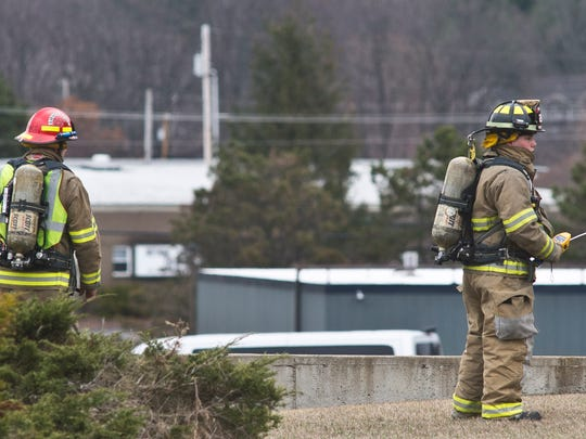 Milton firefighters check for gas readings around NG Advantage on Gonyeau Road in Milton on Saturday morning after a leak released about 350,000 cubic feet of compressed natural gas from a tanker trailer.