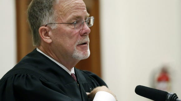 Special Judge Hollis McGehee speaks to attorneys during a status conference Wednesday, Aug. 20, 2014, in the Circuit Court Courtroom of the Jones County Courthouse in Laurel, Miss., regarding the lawsuit by State Sen. Chris McDaniel, R-Ellisville, to overturn results of a Republican primary for U.S. Senate.
