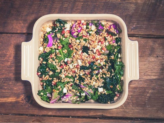 Farmly's slow-roasted meats will be served alongside home-style sides, like this farro and kale salad with feta cheese.