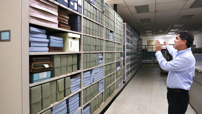 State Archivist Jim Corridan points out a row of storage boxes that hold documents and records from Indiana governors over a period of 138 years, from Gov. William Henry Harrison (governor of the Indiana Territory) in 1801 through Gov. M. Clifford Townsend in 1938, in the Indiana State Archives facility, Thursday, Aug. 20, 2015.