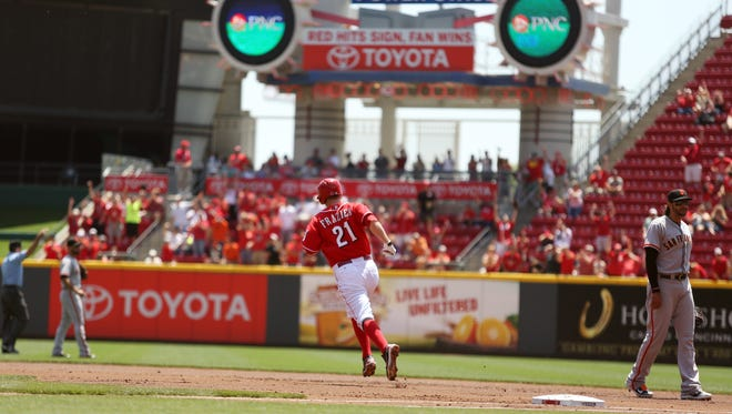 The Reds' Todd Frazier runs the bases after hitting a home run in the first inning Thursday.
