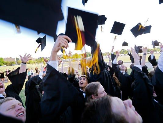 636306431264715237-graduation2.jpg