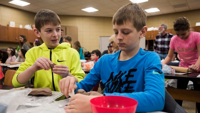Justin Nicewicz, 13, left, forms a piece of clay with his brother, Joseph, of Port Huron, during the 2017 Free College Day at St. Clair County Community College.