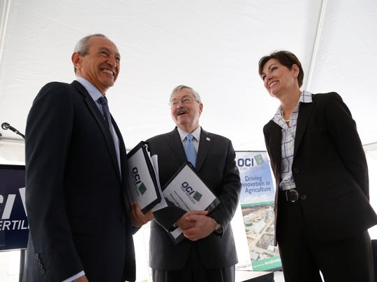 Nassef Sawiris, CEO of OCI N.V. (from left), laughs with Gov. Terry Branstad and Lt. Gov. Kim Reynolds Wednesday, April 19, 2017, as they gather for the ribbon cutting ceremony for the Iowa Fertilizer Company plant in Wever, Iowa.