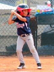 One of the younger batters prepares to swing.