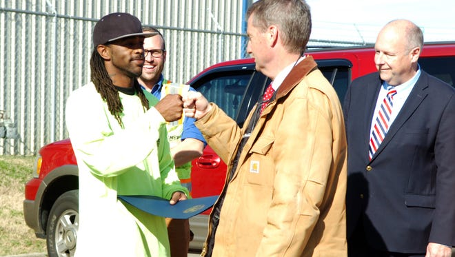 Powell Convenience Center employee Phillip Parks, left, receives a signature fist bump from Knox County Mayor Tim Burchett on what was declared Phillip Parks Day on Nov. 17, 2017. Looking on are Drew Thurman, deputy director of solid waste, and Dwight Van de Vate, senior director of engineering and public works.