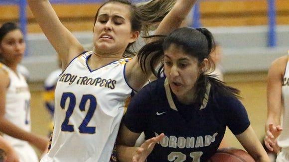 Eastwood's Kaylee Martinez, 22, tries putting a stop to a drive by Coronado's Nehaa Sohail last season.