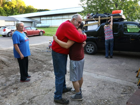 Doug Knoepke, owner of a large dairy farm in Pepin County, Wis., hugs Miguel Hernandez on May 31, 2017, as he prepares to leave after 16 years.