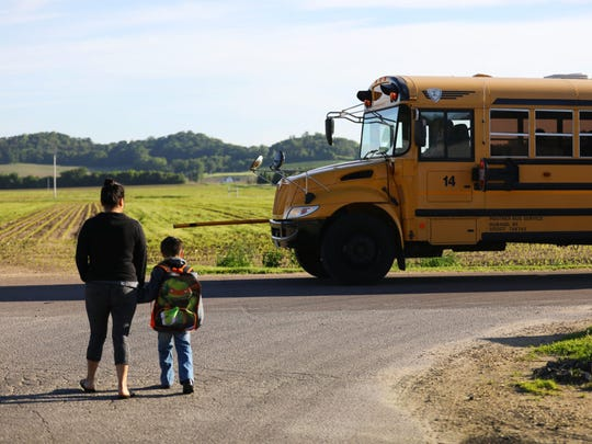 Luisa Tepole walks her son Thomas Hernandez, 5, to the bus on his last day of school in the United States on May 31, 2017. ThomasÕ preschool class held a graduation ceremony later that day. The rest of his classmates will enter kindergarten next fall. Thomas, who is an American citizen, flew to Mexico with his mother and brother Liam a few days later to start a new life with his family in his parentsÕ hometown of Texhuacan, Veracruz.