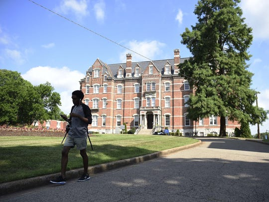 A student walks in front of Jubilee Hall on the Fisk