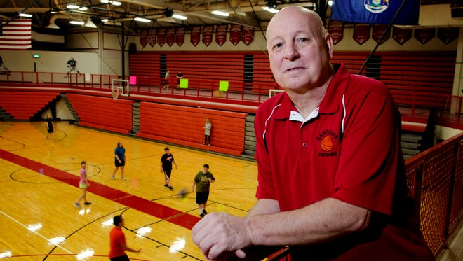 Al DeMott stands overlooking the Sandusky basketball court Wednesday, Dec. 3 in the Mark S. Hund Gymnasium at Sandusky High School. The court is being named after him.