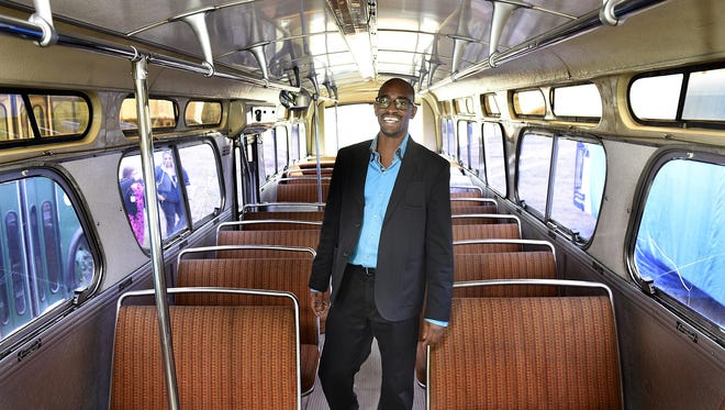 St. Cloud Metro Bus Executive Director Ryan Daniels stands Thursday inside a vintage 1974 Metro Bus under restoration. Daniels was recently named to the Top 40 Under 40 list by Mass Transit magazine.