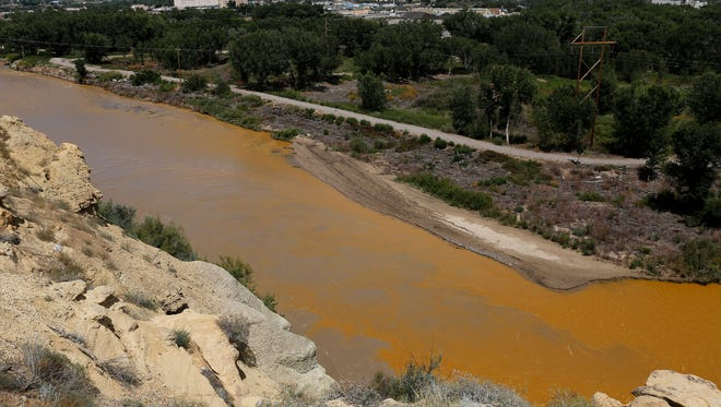 The San Juan River flows near its confluence with the Animas River in Farmington on Aug. 8, 2015, shortly after the Gold King Mine spill.