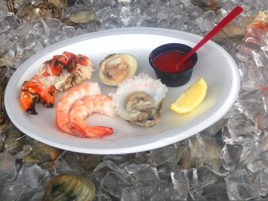 A selection of seafood is served at the raw bar at
