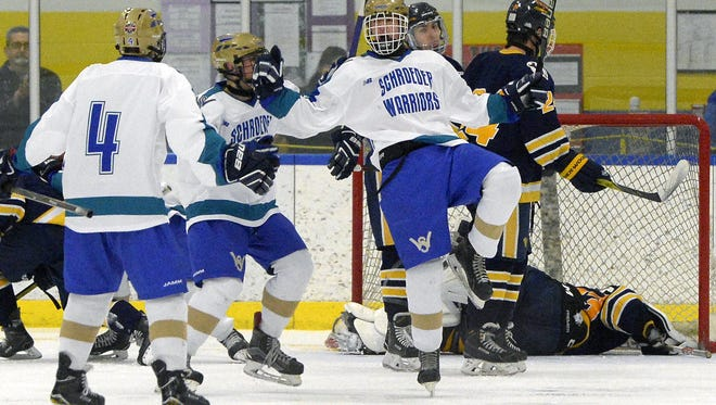 Webster Schroeder's Justin Gibb, right, celebrates during a regular season game at the Webster Ice Arena on Thursday, Feb. 1, 2018 in a 5-2 loss to Victor.