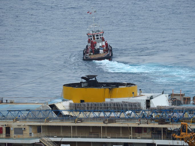 A tug boat pulls the wreck of the Costa Concordia cruise ship after it was refloated, on July 14 .