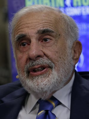 """Bloomberg Icahn Billionaire activist investor Carl Icahn speaks during a Bloomberg Television interview at the Robin Hood Investors Conference in New York, U.S., on Tuesday, Oct. 21, 2014. Icahn said Warren Buffett is sometimes """"way too easy"""" on companies in which his Berkshire Hathaway Inc. invests. Photographer: Peter Foley/Bloomberg *** Local Caption *** Carl Icahn ORG XMIT: 519528253"""