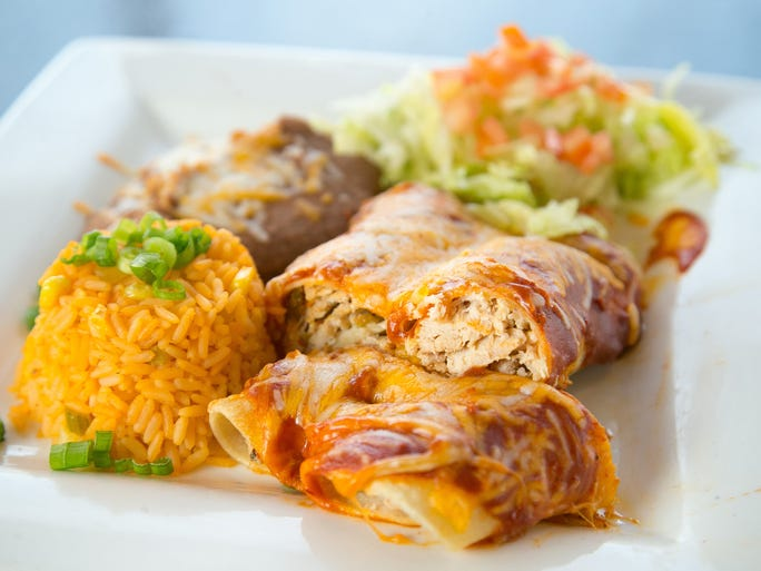 The Chicken Enchilada at the Beach Club Cantina restaurant at the Park West Mall in Peoria on Thursday, July 3, 2014.