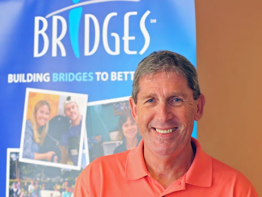 "David Cooke, president at The Bridges Foundation, where adults with special needs are working on art work for the November 16 event in partnership with The Parker Foundation ""Special Art by Special Hands"", held at their location at 1694 Cedar Street, in Rockledge."
