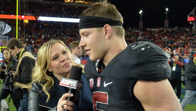 ESPN broadcaster Holly Rowe (left) interviews Stanford Cardinal running back Christian McCaffrey (5) after the Pac-12 Conference football championship game against the Southern California Trojans at Levi's Stadium. Stanford defeated USC 41-22.