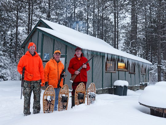 The Old T crew of Chris White, left, Patrick Durkin and Tom Heberlein pose for their annual deer camp photo at Heberlein's shack in Ashland County. They saw no deer.