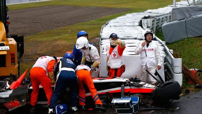 Jules Bianchi receives urgent medical treatment after crashing during the Japanese Formula One Grand Prix.