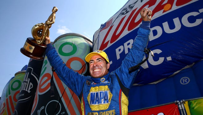 Ron Capps celebrates after winning the Funny Car event Sunday at the Lucas Oil Nationals.