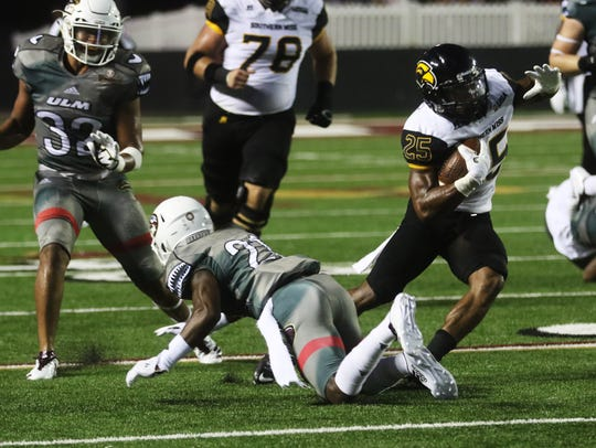 Southern Miss running back Ito Smith avoids the ULM