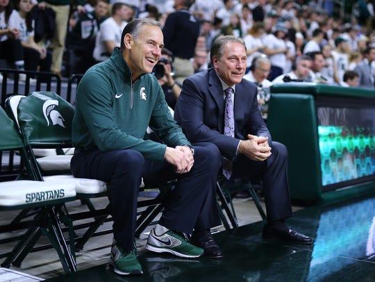 Michigan State coaches Mark Dantonio, left, and Tom