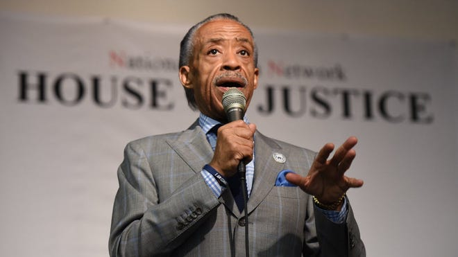 """The Rev. Al Sharpton addresses a group gathered at the House of Justice on Aug. 16, 2014, in New York. Sharpton addressed what he called a """"smear campaign"""" against Ferguson, Mo., shooting victim Michael Brown."""