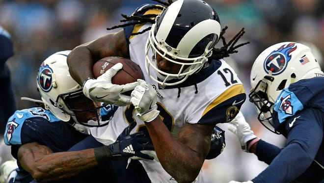 Rams wide receiver Sammy Watkins (12) is tackled by Titans cornerback Tye Smith (33) and safety Kevin Byard (31) in the first quarter at Nissan Stadium on Sunday, Dec. 24, 2017 in Nashville, Tenn.