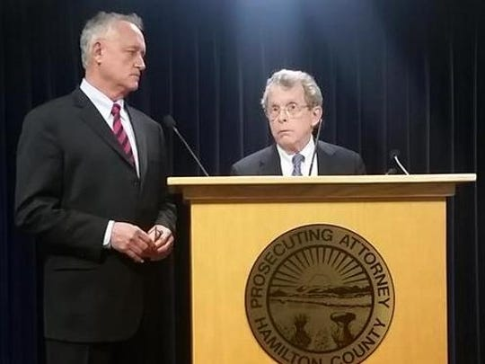 Hamilton County Prosecutor Joe Deter, left, and Ohio AG Mike DeWine at a Monday morning news conference announcing human trafficking charges against a mother.