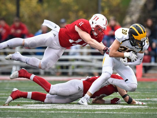 David Franta of St. John's leaps to tackle Brice Panning