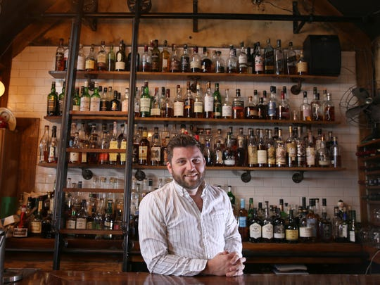 Cameron Phelps is co-owner of The Daily Refresher on Alexander Street. The bar's whiskey wall features more than 300 unique whiskeys.