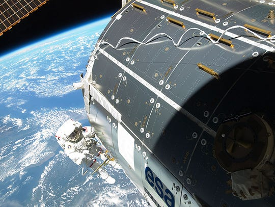 NASA astronaut Randy Bresnik works outside the International