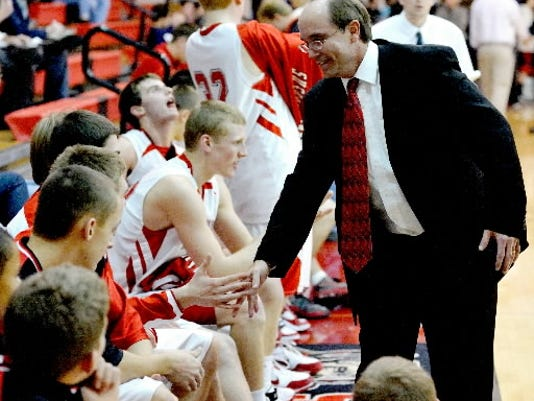 Susquehannock coach John Zerfing celebrates with his players following a 2009 win against Spring Grove in the championship game of the Warrior Holiday Classic. (DAILY RECORD/SUNDAY NEWS - FILE)