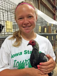 Abby Bean, 15, poses with one of the nine birds she