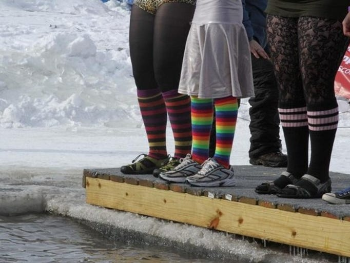 Hundreds of people took the Polar Plunge at Menominee Park in Oshkosh on Saturday, February 15, 2014 to support the Special Olympics.