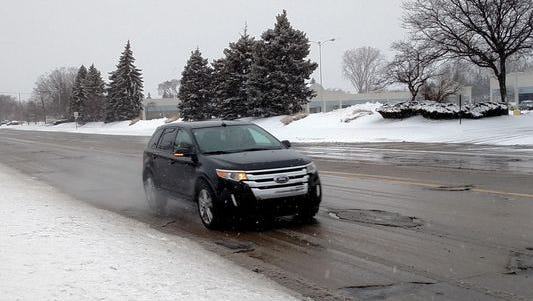 A vehicle drives along Seven Mile earlier this year in this file photo. A snow emergency has been declared in Livonia.