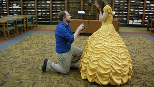 """Joel Lynch, a graduate student at Iowa State University, created a dress similar to the one Belle wears in """"Beauty in the Beast"""" for his girlfriend Cara Szymanski when he proposed to her on Saturday, Jan. 14, 2017."""