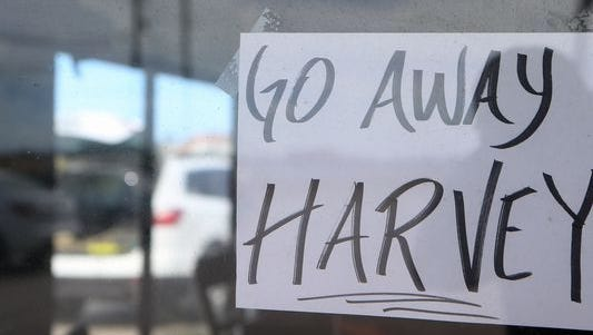 A sign is placed at JB's German Bakery & Cafe in Corpus Christi, Texas, as Hurricane Harvey approaches the area.