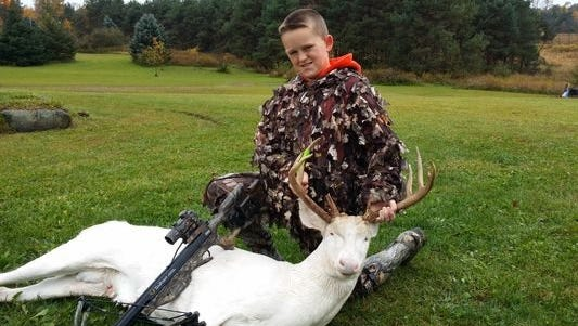 Gavin Dingman, 11, of Oceola Township in Michigan, bagged a rare 12-point albino deer last week, using a crossbow while hunting with his father, Mick Dingman.