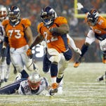 Denver Broncos running back C.J. Anderson (22) breaks free for the game-winning touchdown against the New England Patriots during overtime of an NFL football game, Sunday, Nov. 29, 2015, in Denver. The Broncos defeated the Patriots 30-24. (AP Photo/Jack Dempsey)